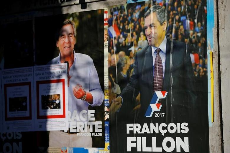 Primary campaign posters of Francois Fillon, member of Les Republicains political party and 2017 presidential candidate of the French centre-right, are seen in Chantenay-Villedieu, western France, December 1, 2016. REUTERS/Stephane Mahe/Files
