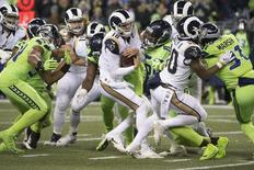 Dec 15, 2016; Seattle, WA, USA;  Los Angeles Rams quarterback Jared Goff (16) is sacked by Seattle Seahawks defensive end Cliff Avril (56) during the second quarter at CenturyLink Field. Mandatory Credit: Troy Wayrynen-USA TODAY Sports
