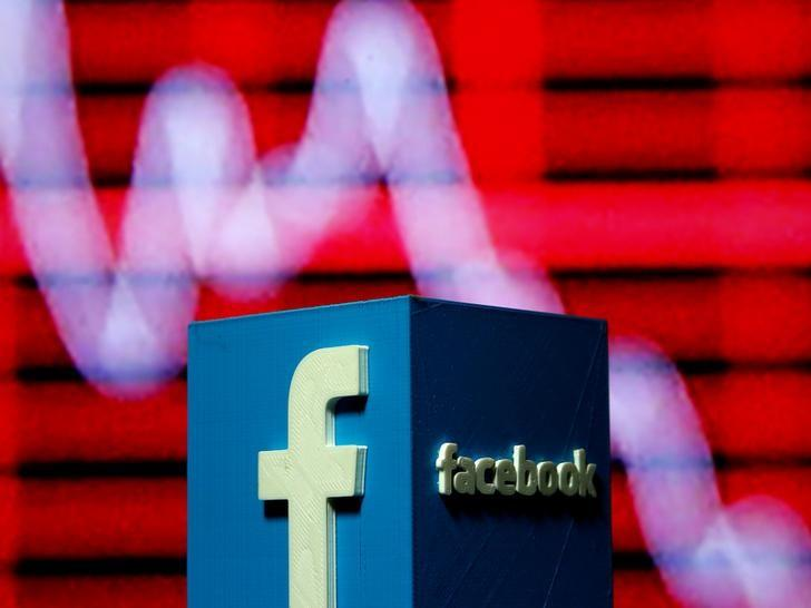 A 3D-printed Facebook logo is seen in front of a displayed stock graph in this illustration taken November 3, 2016.  REUTERS/Dado Ruvic/Illustration