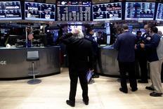 Traders work on the floor of the New York Stock Exchange (NYSE) in New York City, U.S., December 16, 2016.  REUTERS/Brendan McDermid - RTX2VD7J