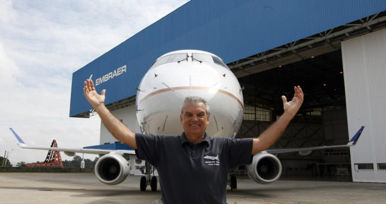 Brazilian aircraft manufacturer Embraer's CEO Paulo Cesar Silva poses in front of a new commercial aircraft E-175 jet, rolled-out in Sao Jose dos Campos, north from Sao Paulo March 12, 2014. REUTERS/Paulo Whitaker
