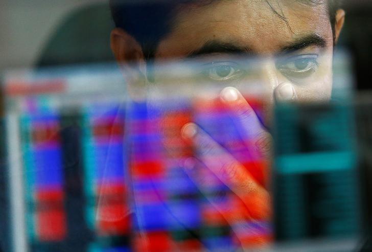 A broker reacts while trading at his computer terminal at a stock brokerage firm in Mumbai, November 9, 2016. REUTERS/Danish Siddiqui/Files