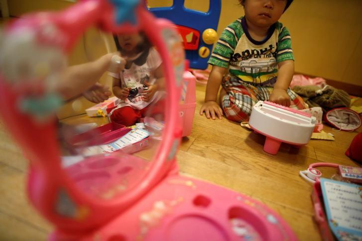 Children play with toys at Futaba Baby Home in Tokyo, Japan, June 21, 2016. REUTERS/Issei Kato/Files