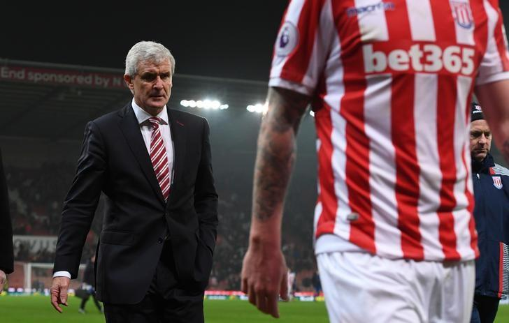 Britain Football Soccer - Stoke City v Leicester City - Premier League - bet365 Stadium - 17/12/16 Stoke City manager Mark Hughes looks dejected after the game  Reuters / Anthony Devlin Livepic