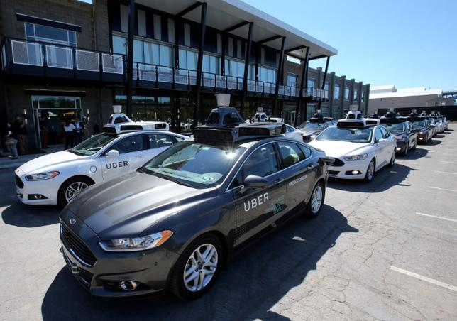 A fleet of Uber's Ford Fusion self driving cars are shown during a demonstration of self-driving automotive technology in Pittsburgh, U.S., September 13, 2016.     REUTERS/Aaron Josefczyk/File Photo