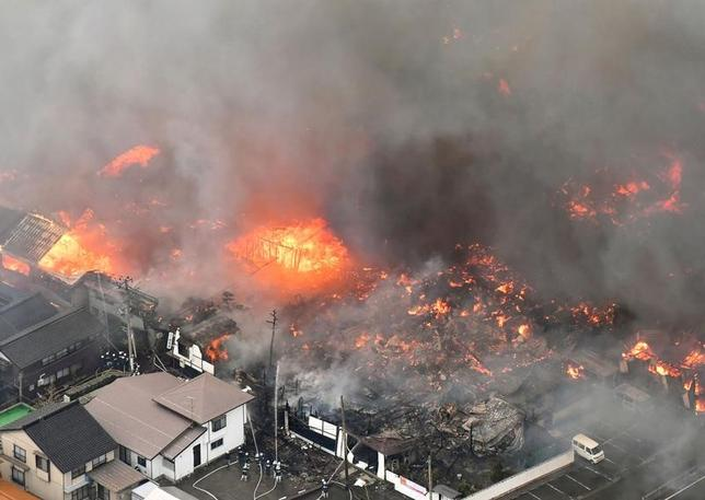 A fire engulfs houses and stores, near JR Itoigawa Station, in Itoigawa, Niigata Prefecture, Japan, in this photo taken by Kyodo December 22, 2016. Mandatory credit Kyodo/via REUTERS