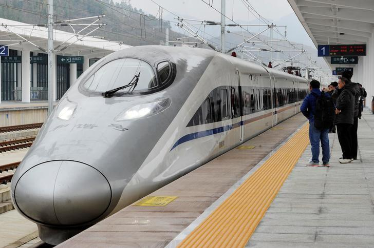 A high-speed railway train linking Shanghai and Kunming, of Yunnan province, is seen at a station during a partial operation, in Anshun, Guizhou province, China, December 28, 2016.   REUTERS/Stringer