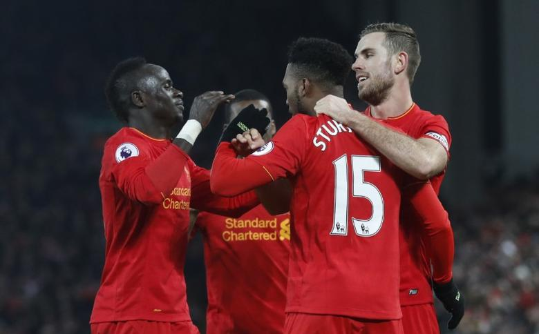 Britain Football Soccer - Liverpool v Stoke City - Premier League - Anfield - 27/12/16 Liverpool's Daniel Sturridge celebrates scoring their fourth goal with team mates Action Images via Reuters / Carl Recine Livepic