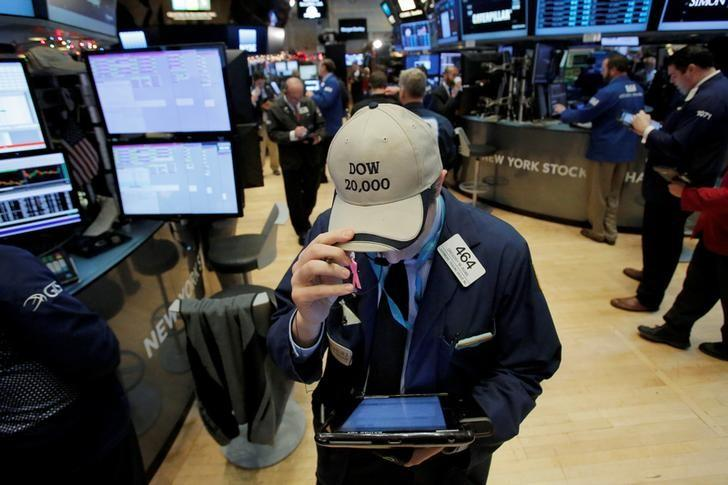 A trader works on the floor at the New York Stock Exchange (NYSE) in Manhattan, New York City, U.S. December 28, 2016. REUTERS/Andrew Kelly