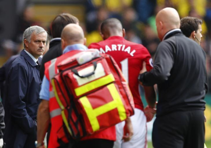 Britain Football Soccer - Watford v Manchester United - Premier League - Vicarage Road - 18/9/16. Manchester United's Anthony Martial walks off injured to be substituted as manager Jose Mourinho looks on. Reuters / Eddie Keogh