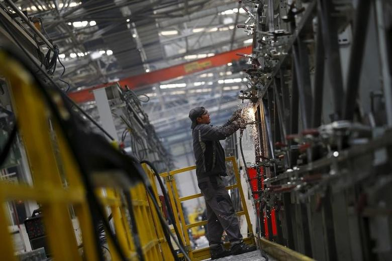 A man works at the assembly line of the MAN Bus Production Center in Ankara, Turkey, July 29, 2015. According to a statement from the company, it employs 1,600 workers on the 320,000 square metre plant where seven vehicles are produced a day to be used for the MAN and NEOPLAN brand of city and intercity buses, as well as touring coaches. Picture taken July 29, 2015.  REUTERS/Umit Bektas   - RTX1MERZ