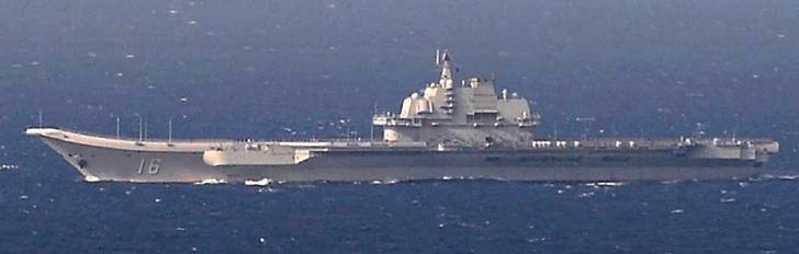 China's Kuznetsov-class aircraft carrier Liaoning sails the water in East China Sea, in this handout photo taken December 25, 2016 by Japan Self-Defence Force and released by the Joint Staff Office of the Defense Ministry of Japan. Joint Staff Office of the Defense Ministry of Japan/HANDOUT via REUTERS/Files