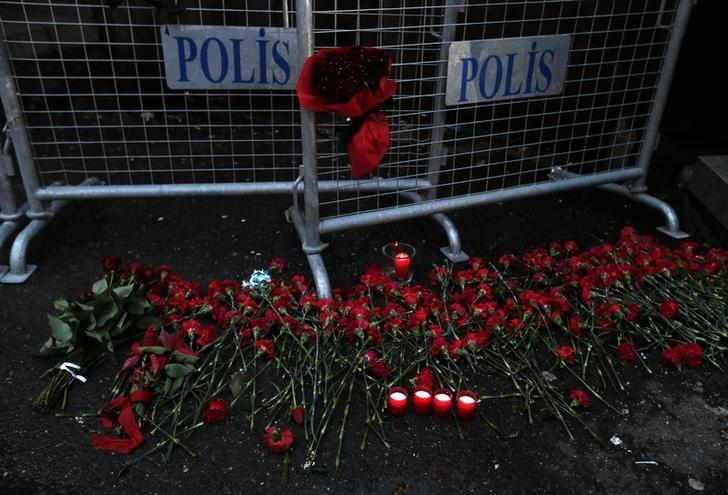 Flowers are placed near the entrance of Reina nightclub by the Bosphorus, which was attacked by a gunman, in Istanbul, Turkey, January 1, 2017. REUTERS/Huseyin Aldemir