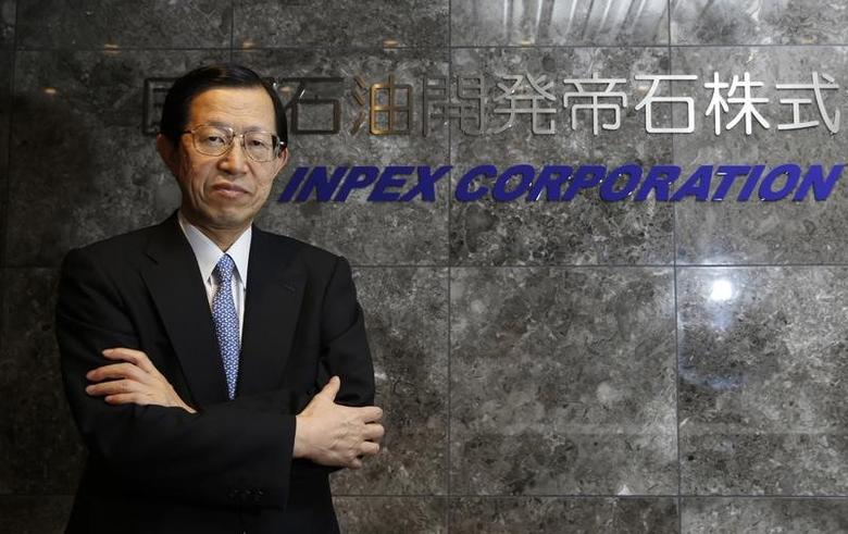 Japan's biggest oil and gas explorer Inpex Corp President and CEO Toshiaki Kitamura poses in front of the company logo before an interview with Reuters at the company headquarters in Tokyo January 9, 2015.   REUTERS/Toru Hanai/Files