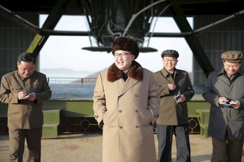 FILE PHOTO: North Korea leader Kim Jong Un smiles as he visits Sohae Space Center in Cholsan County, North Pyongan province for the testing of a new engine for an intercontinental ballistic missile (ICBM) in this undated photo released by North Korea's Korean Central News Agency (KCNA) on April 9, 2016.    KCNA/via REUTERS/File Photo