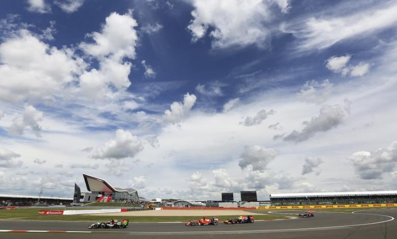 Formula One drivers race through Club Corner during the British Grand Prix at the Silverstone Race Circuit, central England, July 6, 2014. REUTERS/Paul Hackett