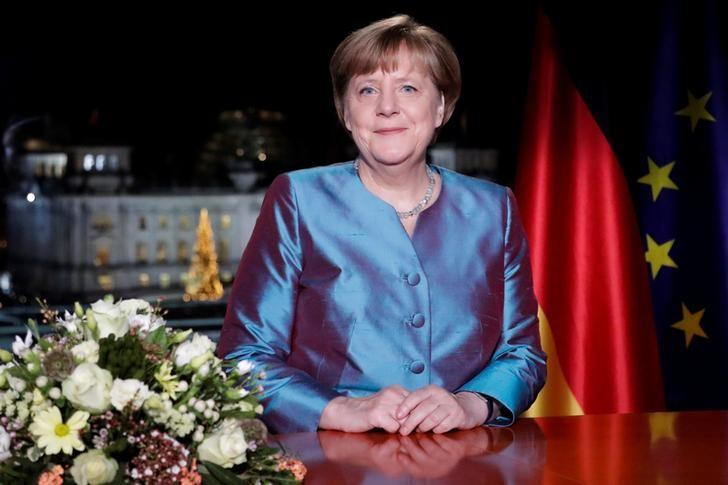 German Chancellor Angela Merkel poses for photographs after the television recording of her annual New Year's speech at the Chancellery in Berlin, Germany, December 30, 2016. REUTERS/Markus Schreiber/Pool/Files
