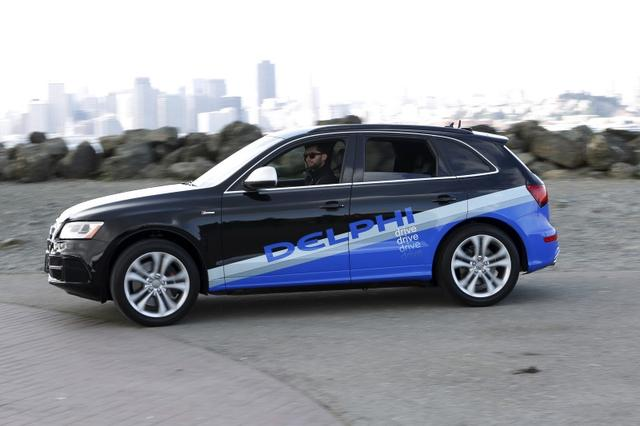 An autonomous car from Delphi departs Treasure Island for a cross-country trip from San Francisco to New York City in San Francisco, California March 22, 2015. REUTERS/Stephen Lam