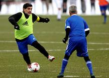 Diego Armando Maradona (L) in action during the FIFA Legends tournament ahead of the FIFA awards ceremony in Zurich, Switzerland, January 9, 2017. REUTERS/Arnd Wiegmann
