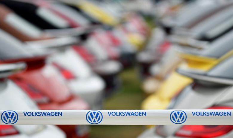 FILE PHOTO:  A Volkswagen banner is seen in front of Beetle cars at the  ''Sunshinetour 2016'' in Travemuende, Germany, August 20, 2016.   REUTERS/Fabian Bimmer/File Photo