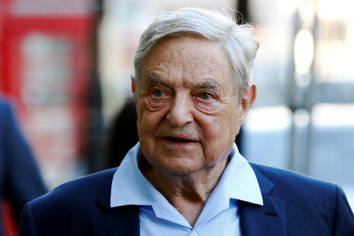 Business magnate George Soros arrives to speak at the Open Russia Club in London, Britain June 20, 2016. REUTERS/Luke MacGregor/File Photo