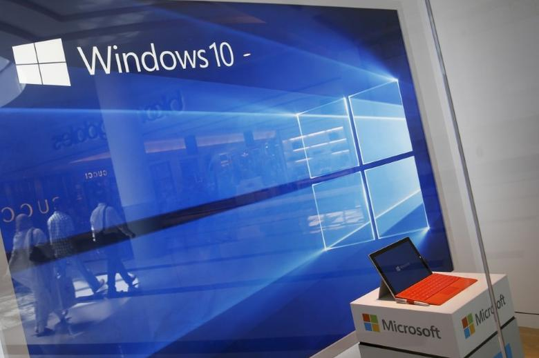 FILE PHOTO - A display for the Windows 10 operating system is seen in a store window at the Microsoft store at Roosevelt Field in Garden City, New York July 29, 2015. REUTERS/Shannon Stapleton