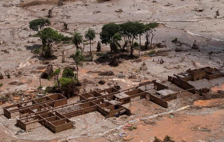 The debris of the municipal school of Bento Rodrigues district, which was covered with mud after a dam owned by Vale SA and BHP Billiton Ltd burst, is pictured in Mariana, Brazil, November 10, 2015.     REUTERS/Ricardo Moraes/File photo