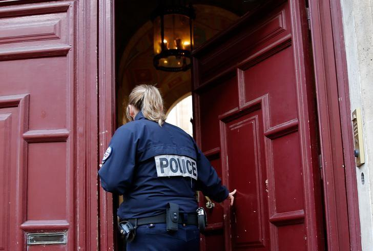 A police officer stands guard at the entrance of a luxury residence on the Rue Tronchet in central Paris, France, October 3, 2016 where masked men robbed U.S. reality TV star Kim Kardashian West at gunpoint early on Monday, stealing jewellery worth millions of dollars, police and her publicist said.  REUTERS/Gonzalo Fuentes/Files