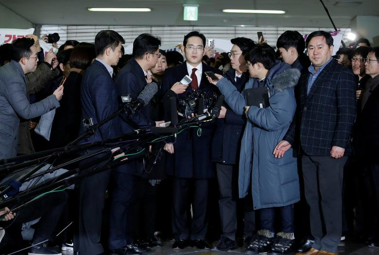 Jay Y. Lee, center, vice chairman of Samsung Electronics, speaks as he arrives to be questioned as a suspect in bribery case in the influence-peddling scandal that led to the president's impeachment at the office of the independent counsel in Seoul, South Korea, Thursday, Jan. 12, 2017. REUTERS/Ahn Young-joon/Pool