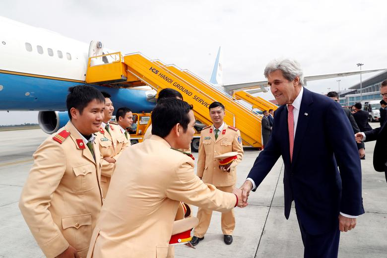 U.S. Secretary of State John Kerry greets police officers as he boards his plane at Hanoi Airport as he departs, Friday, Jan. 13, 2017 in Hanoi, Vietnam. REUTERS/Alex Brandon/Pool