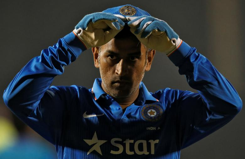 India A's captain MS Dhoni takes a break during the match. REUTERS/Danish Siddiqui