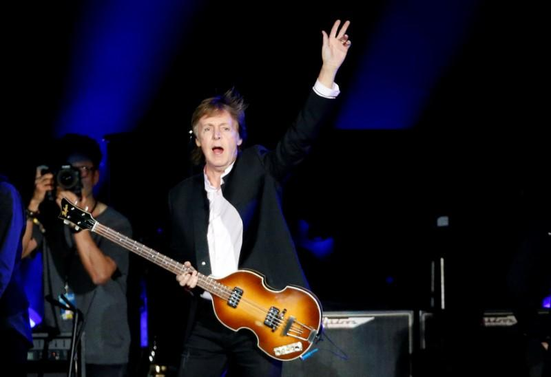 Musician Paul McCartney Waves As He Takes The Stage To Perform At Desert Trip Music Festival Empire Polo Club In Indio California US October 8