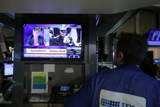 A trader watches the Trump inauguration on TV on the floor of the New York Stock Exchange (NYSE) in Manhattan, New York City, U.S., January 20, 2017. REUTERS/Stephen Yang