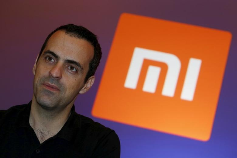 Xiaomi's Vice President Hugo Barra looks on in front of the company's logo during a group interview after the launching ceremony of Redmi Note 3 in Hong Kong, China March 21, 2016.      REUTERS/Bobby Yip - RTSBEFO