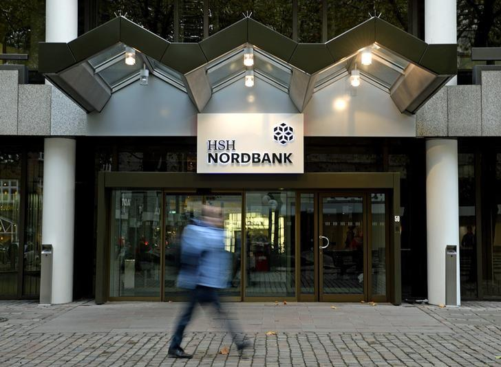 A pedestrian walks past the HSH Nordbank building in downtown Hamburg, October 25, 2014.     REUTERS/Fabian Bimmer (GERMANY  - Tags: BUSINESS)