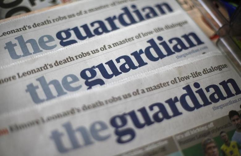 Copies of the Guardian newspaper are displayed at a news agent in London August 21, 2013. REUTERS/Suzanne Plunkett