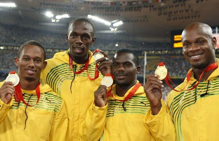 Gold medalists (L - R) Nesta Carter, Michael Frater, Usain Bolt, Asafa Powell of Jamaica pose during the medal ceremony for the men's 4 x 100m relay final of the athletics competition in the National Stadium at the Beijing 2008 Olympic Games August 23, 2008. REUTERS/Mike Blake/Files