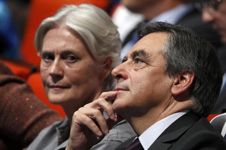 FILE PHOTO - French politician Francois Fillon, member of the conservative Les Republicains political party and his wife Penelope (L) attend a final rally ahead of the first round of vote to choose the conservative candidate for France's presidential election in Paris, France, November 18, 2016. REUTERS/Charles Platiau/File Photo