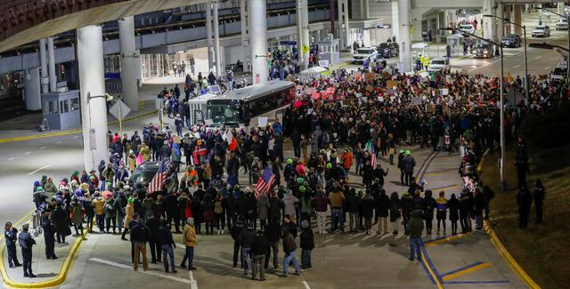 People gather to protest against the travel ban imposed by U.S. President Donald Trump's executive order, at O'Hare airport in Chicago, Illinois, U.S. January 28, 2017.  REUTERS/Kamil Krzaczynski