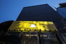 A billboard displays the logo of Snapchat above Times Square in New York March 12, 2015. REUTERS/Lucas Jackson/File Photo