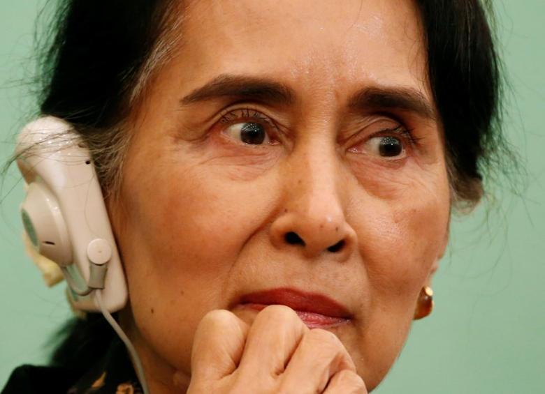 Myanmar State Counselor Aung San Suu Kyi listens to a reporter's question during a news conference at the Japan National Press Club in Tokyo, Japan November 4, 2016. REUTERS/Issei Kato