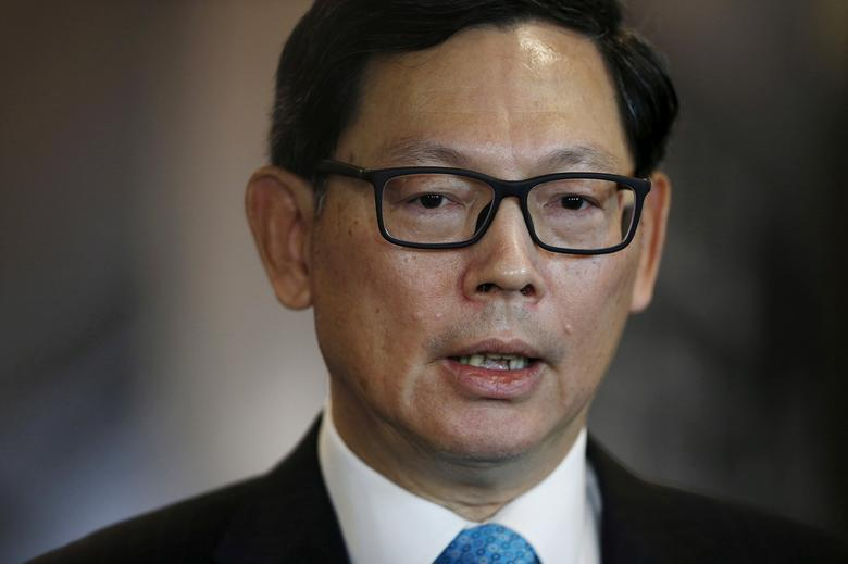 FILE PHOTO: Hong Kong Monetary Authority Chief Executive Norman Chan speaks to the media after attending the Asian Financial Forum in Hong Kong, China January 18, 2016. REUTERS/Bobby Yip /File Photo