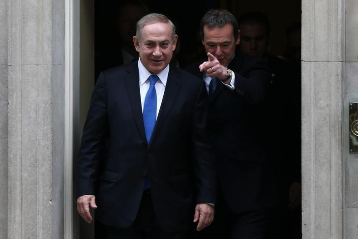 Israel's Prime Minister Benjamin Netanyahu (L) walks out of 10 Downing Street after his meeting with Britain's Prime Minister Theresa May in London, February 6, 2017.    REUTERS/Neil Hall