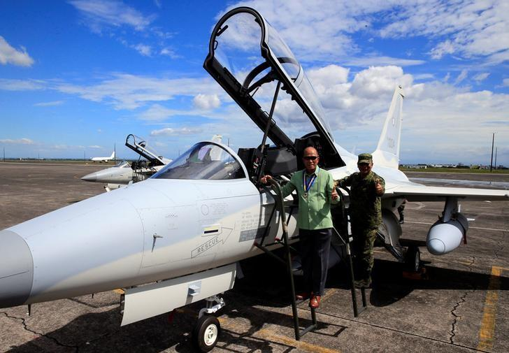 Philippine Defense Secretary Delfin Lorenzana (L) with Armed Forces Chief of Staff Ricardo Visaya gives a thumbs-up sign while on a FA-50 fighter jet, newly purchased from South Korea, upon arrival at a Hangar in Clark air base, Angeles city, Pampanga province, north of Manila, Philippines December 1, 2016. REUTERS/Romeo Ranoco/Files