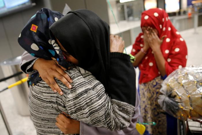 Roodo Abdishakur (2nd L), a Somali national who was delayed entry to the U.S. because of the recent travel ban, is greeted by her mother Zahra Warsma (L) at Washington Dulles International Airport in Chantilly