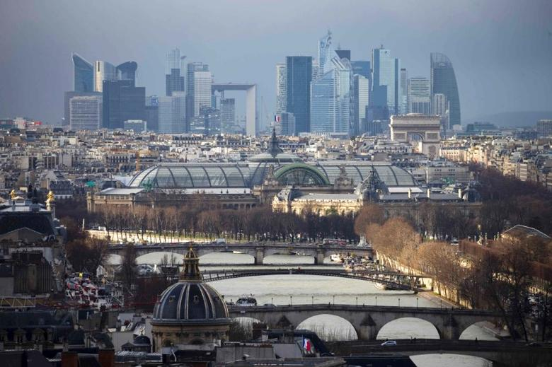 FILE PHOTO: General view of the skyline of La Defense business district (Rear) as the the Grand Palais is seen in central Paris, France, January 14, 2016.   REUTERS/Charles Platiau/File Photo - RTX2ZVJ3