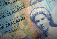 Reserve Bank of New Zealand dollar notes are pictured in Singapore June 22, 2006. REUTERS/Dennis Owen/File Photo