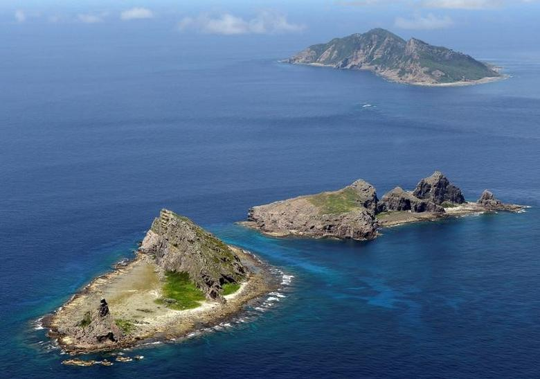 FILE PHOTO - A group of disputed islands, Uotsuri island (top), Minamikojima (bottom) and Kitakojima, known as Senkaku in Japan and Diaoyu in China is seen in the East China Sea, in this photo taken by Kyodo September 2012.  Mandatory credit. REUTERS/Kyodo
