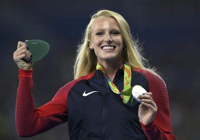 2016 Rio Olympics - Athletics - Victory Ceremony - Women's Pole Vault Victory Ceremony - Olympic Stadium - Rio de Janeiro, Brazil - 20/08/2016. Sandi Morris (USA) of USA poses with her silver medal.   REUTERS/Dylan Martinez