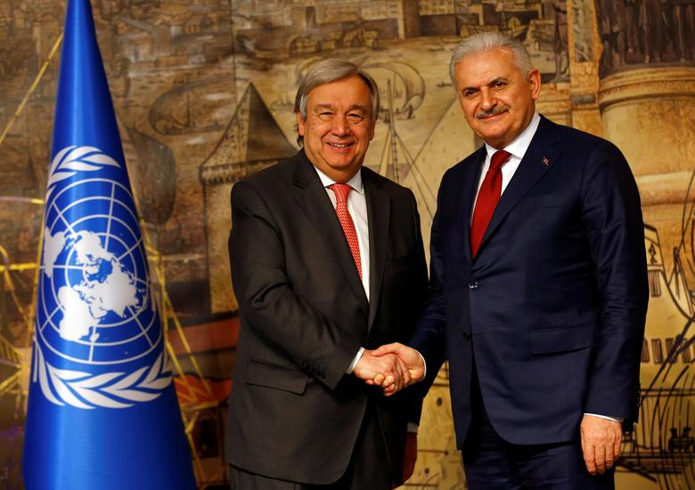 Turkish Prime Minister Binali Yildirim (R) shakes hands with U.N. Secretary-General Antonio Guterres during a news conference in Istanbul, Turkey, February 10, 2017. REUTERS/Murad Sezer